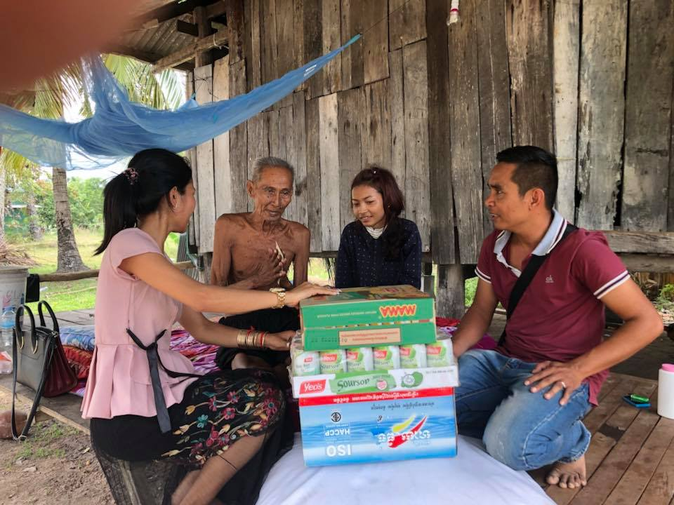 Kampot senior couple receiving gifts